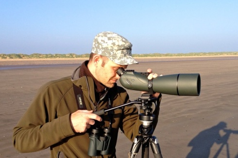 Attila is scanning the mixed flock of waders. © Gyorgy Szimuly